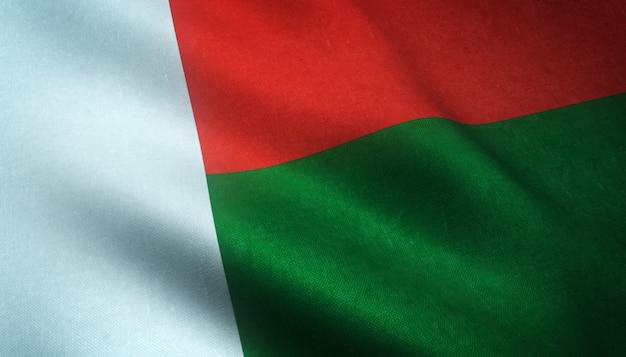 Primer plano de la bandera ondeante de madagascar con texturas interesantes Foto gratis