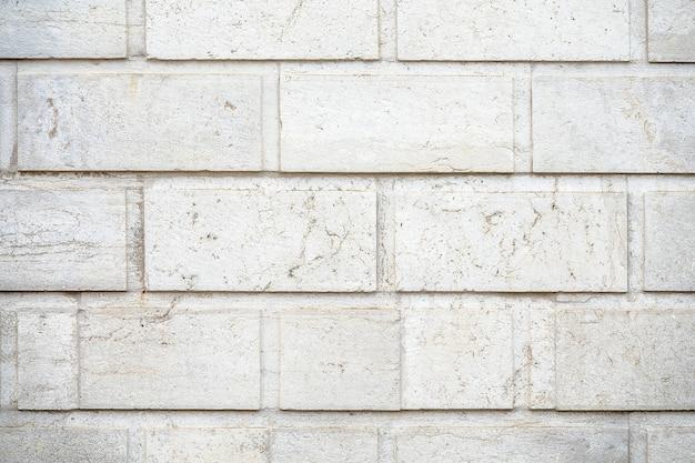 Primer plano de una pared de fondo de piedras rectangulares blancas Foto gratis