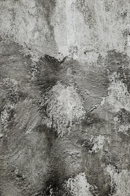 Primer plano vertical de una pared gris bajo las luces - cool fors Foto gratis