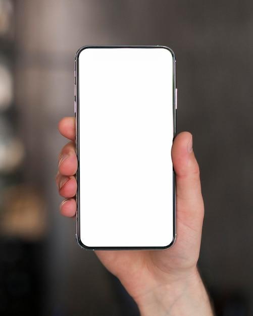 Primer teléfono inteligente con espacio de copia Foto gratis