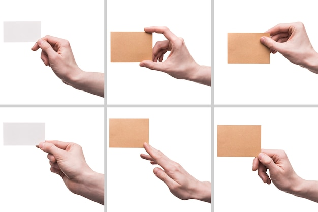 Recortar manos con tarjetas de visita Foto gratis