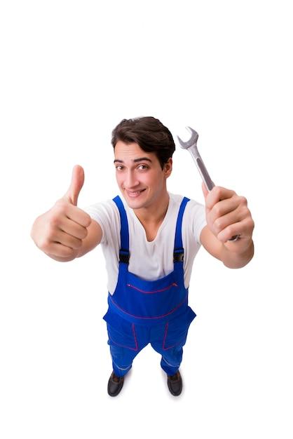 Reparador divertido con las herramientas aisladas en blanco Foto Premium
