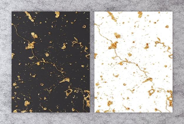 Representación 3d de mármol blanco y negro con lámina dorada. Foto Premium