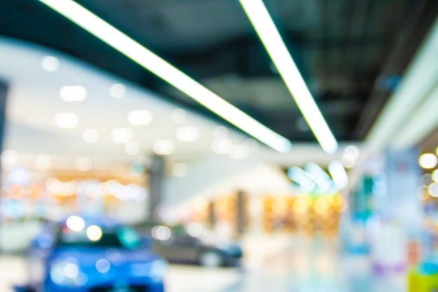 Resumen borroso con bokeh y centro comercial defocused en grandes almacenes Foto Premium