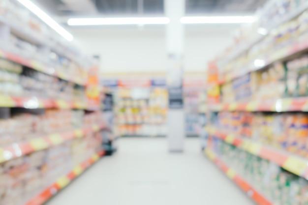 Resumen comercial desenfoque y desenfoque en el interior de los grandes almacenes Foto gratis