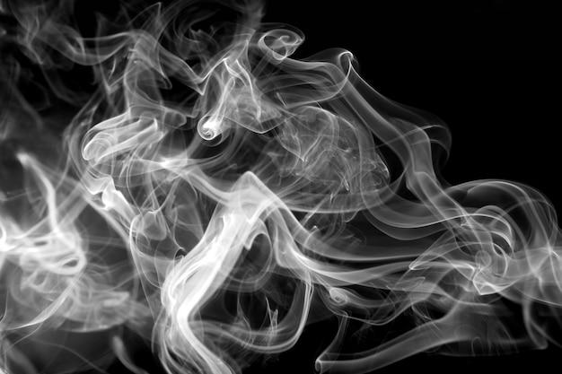 Resumen humo blanco sobre negro. Foto Premium