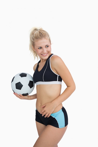 5b0bf6d888a62 Retrato de mujer feliz en ropa deportiva con fútbol