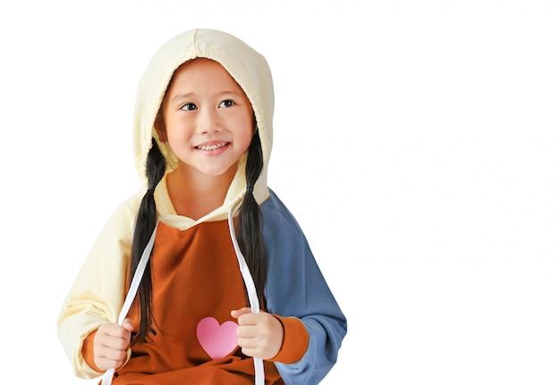 ad14ed768fe9 El retrato de la pequeña muchacha asiática del niño en capilla en la ...