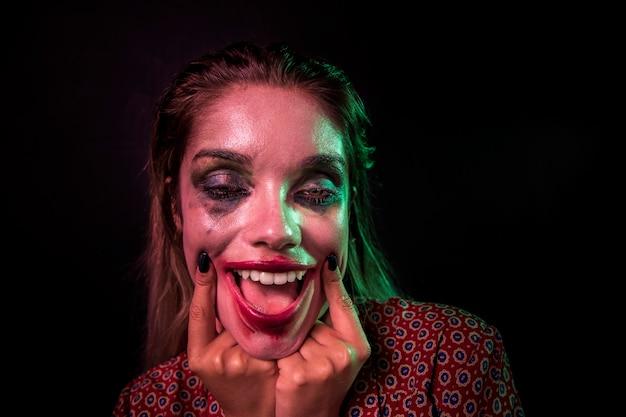 Retrato de un personaje de terror de payaso maquillaje Foto gratis