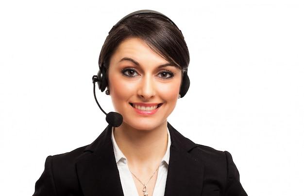 Retrato de un representante del cliente hermoso aislado en blanco Foto Premium