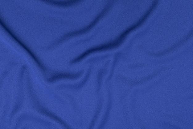 Ropa deportiva tela textura de fondo. vista superior de la superficie textil de tela. camiseta de fútbol azul con copyspace. Foto Premium