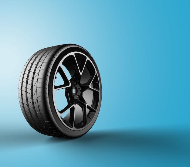 Rueda de coche aislada en un fondo azul Foto Premium