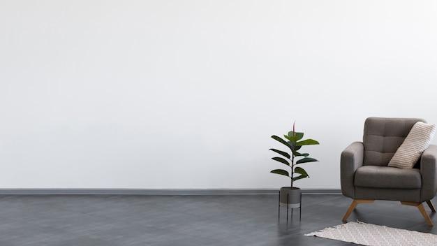 Sala de estar minimalista con sillón y planta. Foto Premium