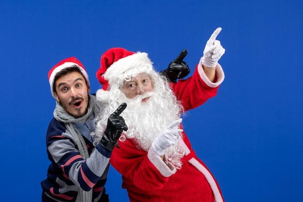 Santa claus, vista frontal, con, macho joven Foto gratis