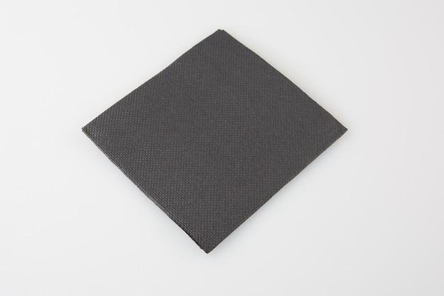 Servilleta de papel negro aislada en blanco Foto Premium