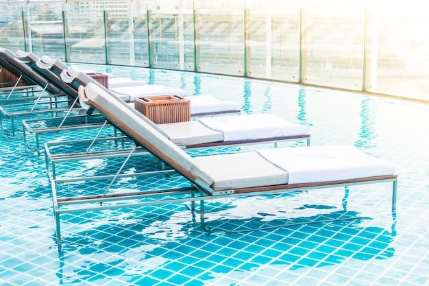 Silla de piscina descargar fotos gratis for Sillas de piscina
