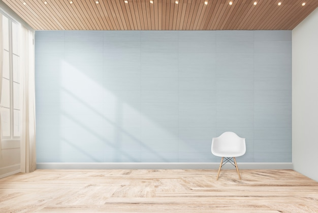 Silla en una habitación azul Foto gratis