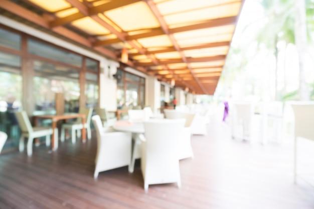 Sillas y mesas de exterior borrosas descargar fotos gratis for Mesas y sillas para exterior