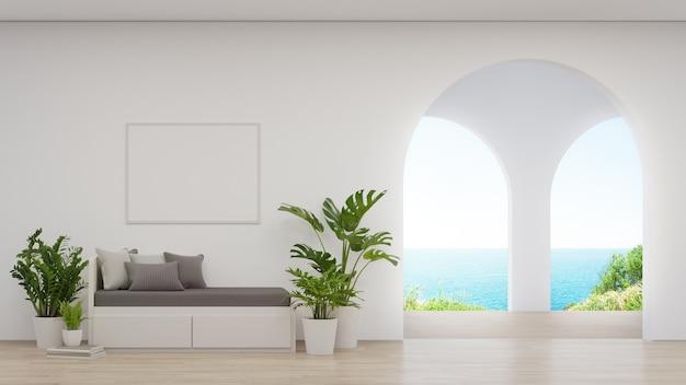 Sofá cerca del marco de imagen en blanco en la pared blanca. Foto Premium