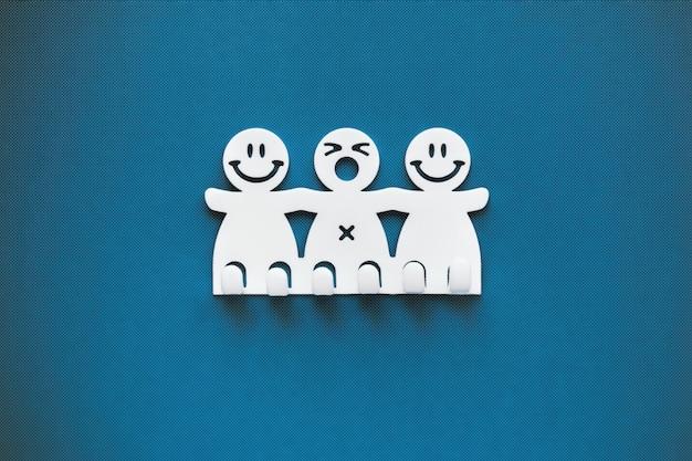 Sonrisas felices y tristes. figuras de plástico blanco sobre fondo azul Foto Premium