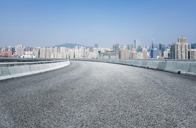 Suelo de asfalto y paisaje arquitectónico urbano. Foto Premium