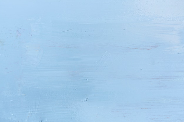 Superficie de madera pintada con trazos de pintura. Foto gratis
