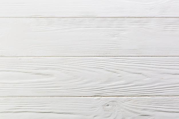 Superficie de madera rugosa pintada de blanco Foto gratis