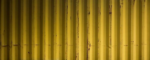 Superficie de textura y fondo de metal corrugado amarillo viejo Foto Premium