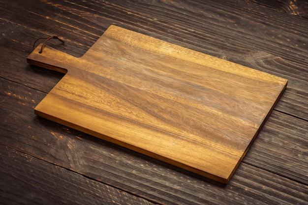 Tabla de cortar de madera Foto gratis
