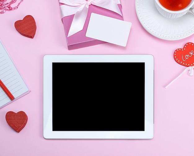 Tableta electrónica con pantalla blanca en blanco. Foto Premium