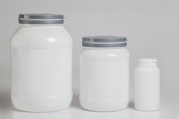 Tarros con complementos alimenticios Foto Premium
