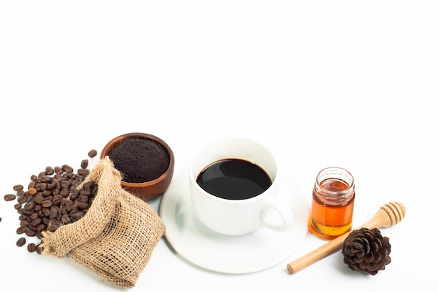 Cup of latte coffee and honey coffee beans on white background ...