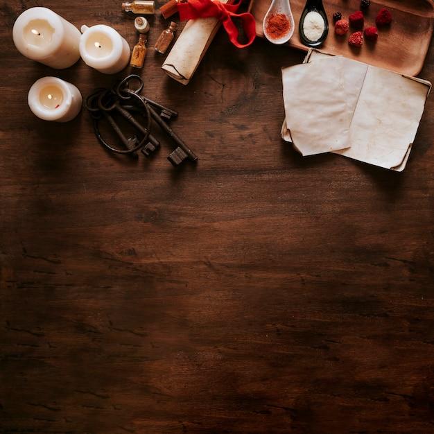 Teclas cerca de velas e ingredientes Foto gratis