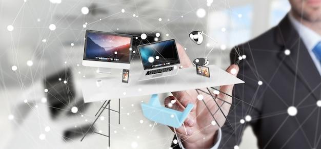 Teléfono y tableta conmovedores del ordenador portátil del escritorio del vuelo del hombre de negocios con su finger Foto Premium