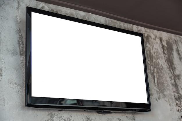Televisión con pantalla en blanco en la pared Foto gratis