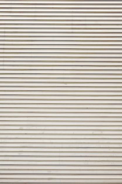 Textura brillante de acero de la puerta del obturador del balanceo con lineas horizontales Foto Premium