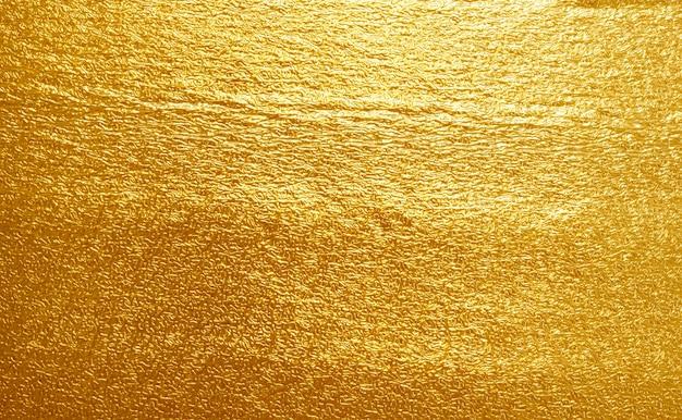 Textura brillante de hoja amarilla de oro Foto Premium