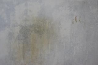 Textura de la pared con pintura gris y amarillo for Pintura pared gris azulado