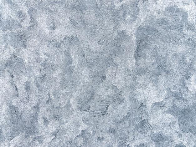 Textura decorativa yeso azul que imita el viejo fondo de la pared de peeling Foto Premium