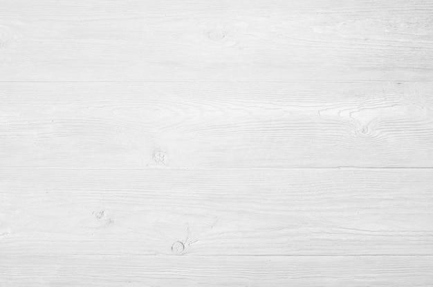 Textura de madera pintada blanca lamentable resistida vintage como fondo Foto Premium