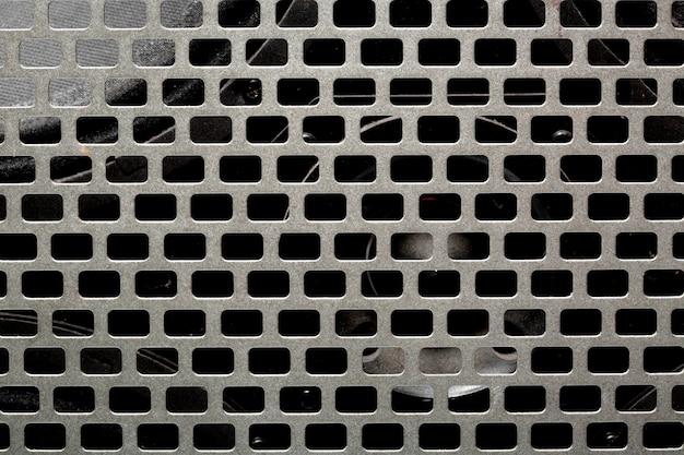 Textura de malla de acero del instrumento musical. altavoz amplificador de audio negro Foto Premium