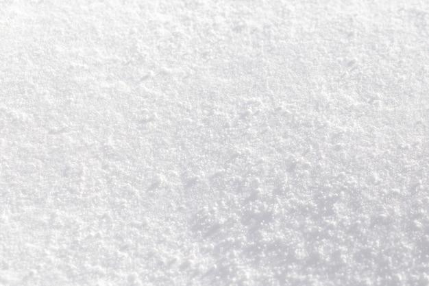 Textura de nieve blanca reluciente bajo el sol. Foto Premium