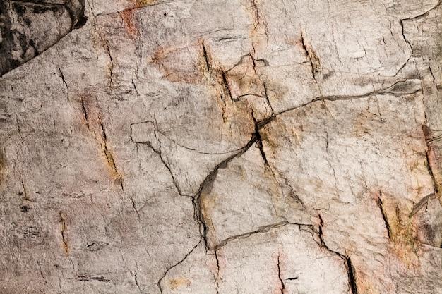 Textura de pared de piedra apilada agrietada Foto Premium
