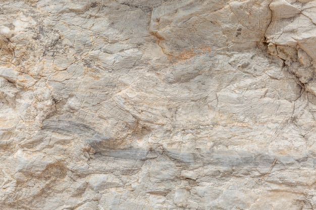 La textura de la superficie de la piedra natural, primer plano. material de construcción de civilizaciones antiguas. antecedentes. espacios para texto. Foto Premium