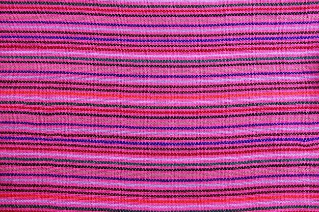 Textura de tela macro rosa vibrante sarape mexicano Foto Premium