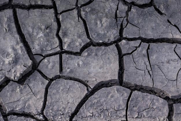 Textura de tierra seca. la tierra seca y agrietada en el desierto, barro, arena, destrucción, barro, fenómenos naturales Foto Premium