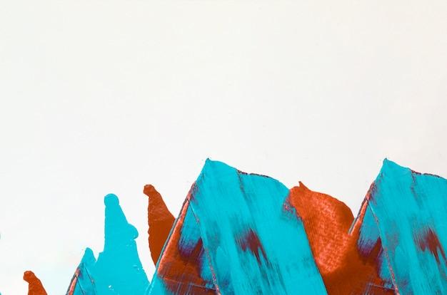 Trazos naranjas y azules con espacio de copia. Foto gratis