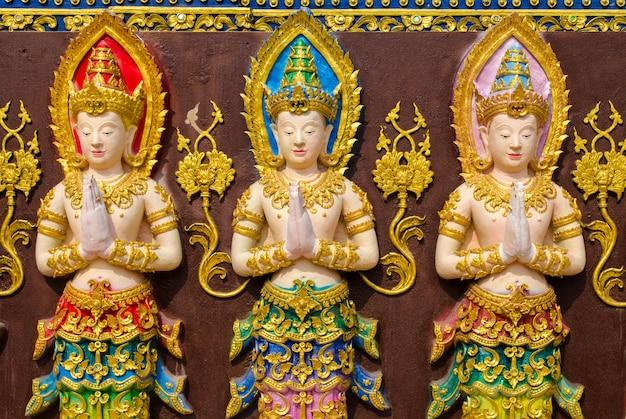 Tres estatuas de hadas Foto Premium