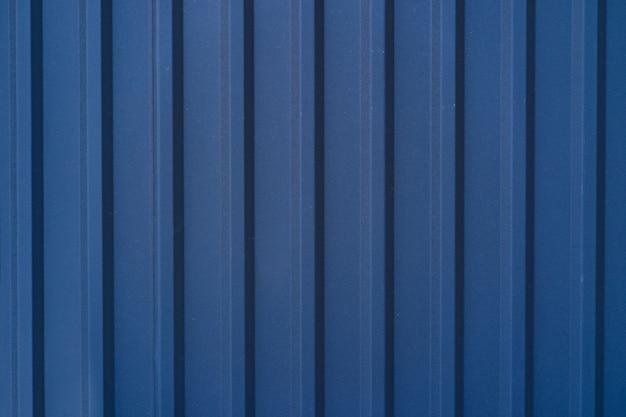 Valla de estaño galvanizado azul forrado de fondo. textura de metal Foto gratis