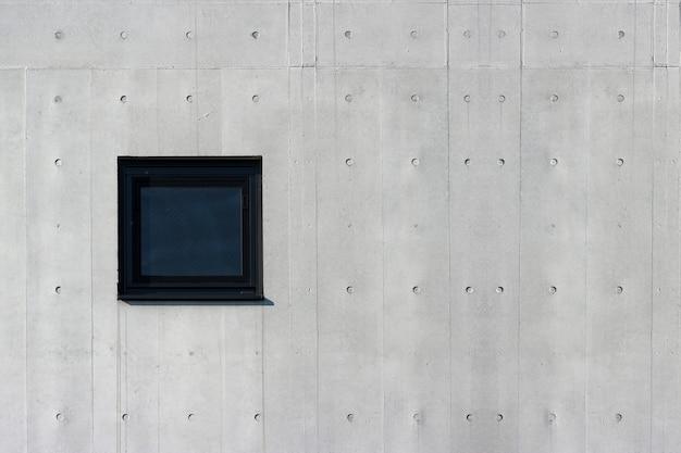 Ventana de cristal cuadrada en fondo envejecido del muro de cemento del cemento. para cualquier trabajo de diseño vintage. Foto Premium